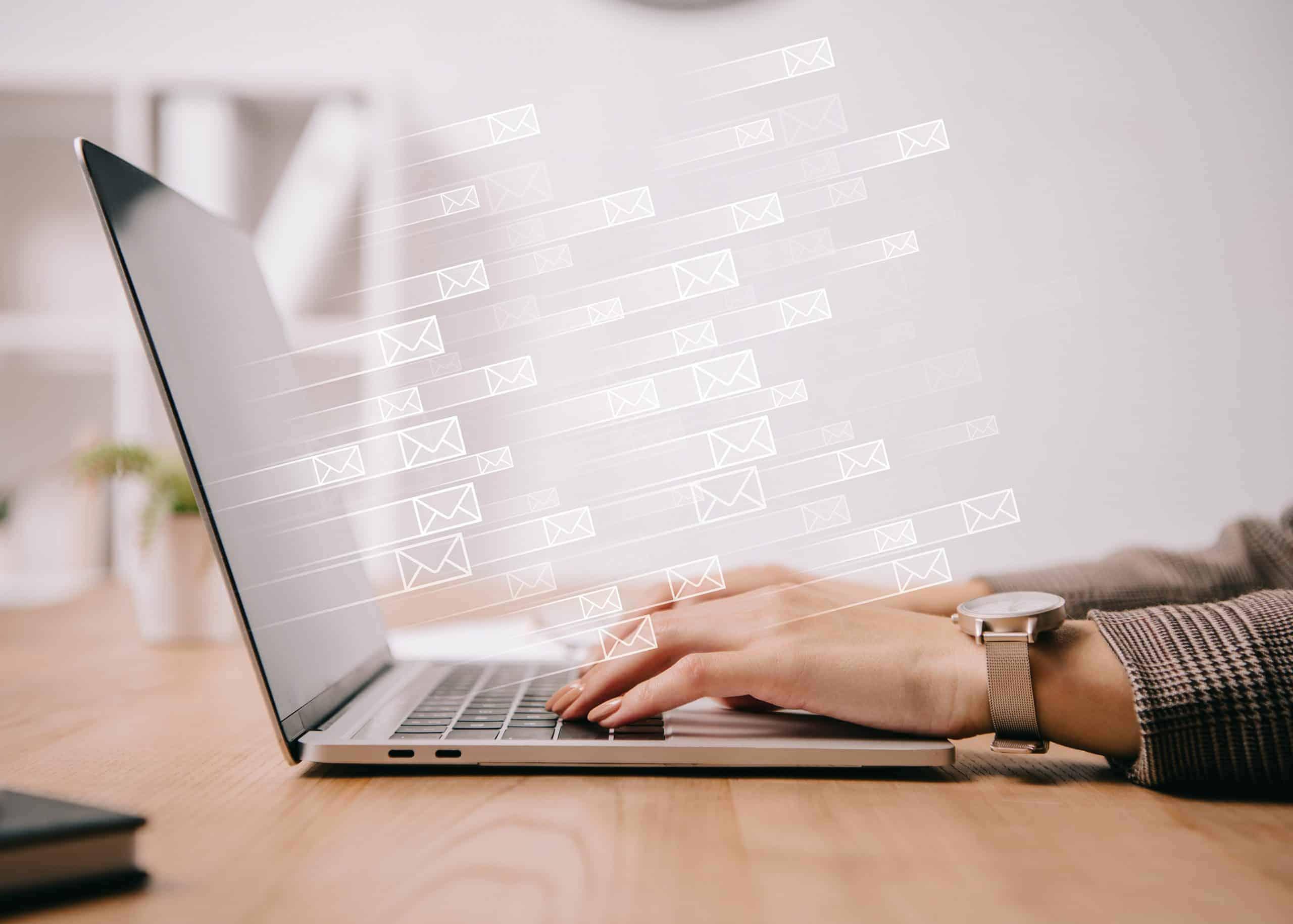 email management software hands laptop